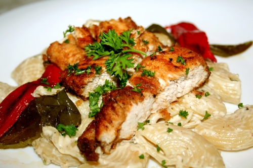 Chicken with creamy tarragon, lemon and garlic pasta and roasted peppers